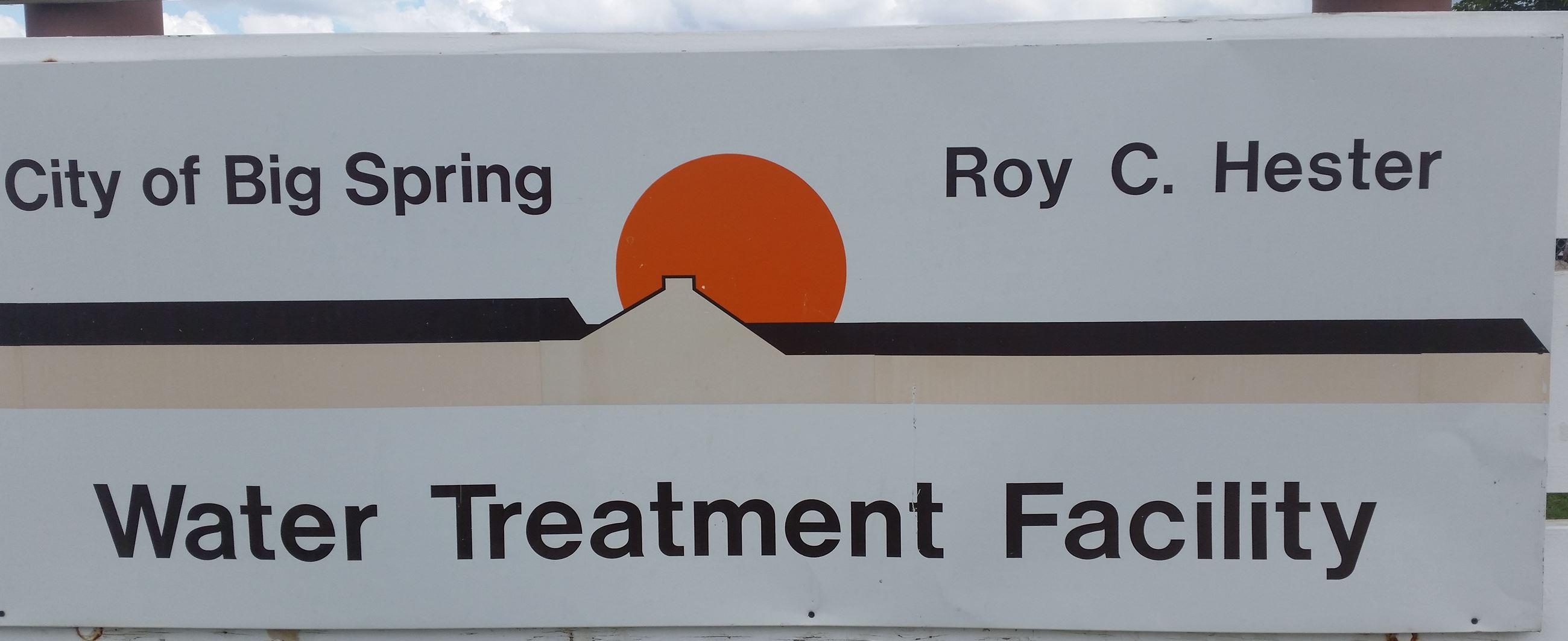 A sign for the Roy Hester Water Treatment Plant with the Big Spring City Logo