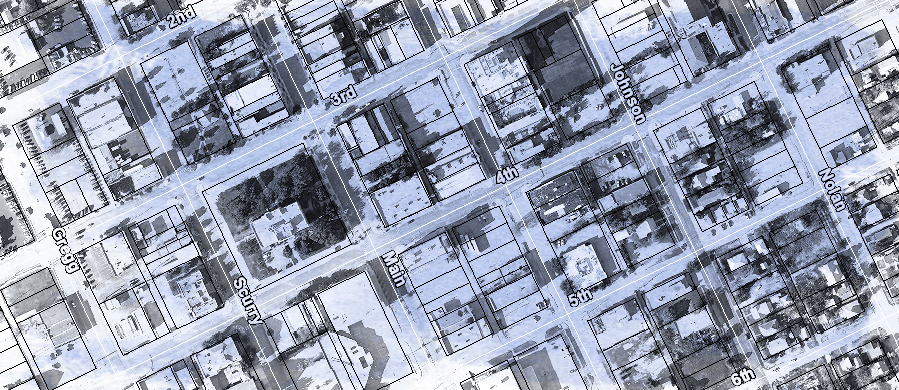 A black and white aerial view image of the downtown area of Big Spring with parcel lines